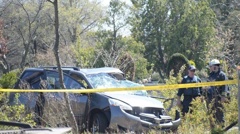 Authorities at the crash scene Wednesday on the