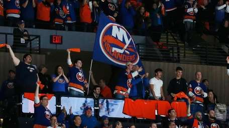 Islanders fans celebrate a during the third period