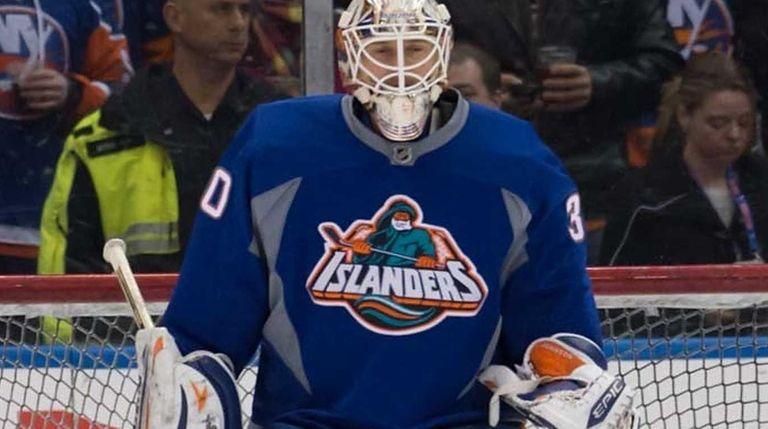 """Goalie Chad Johnson wears the Islanders' """"Fisherman"""" jersey"""