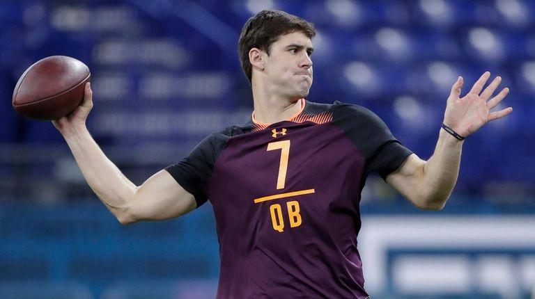Duke quarterback Daniel Jones runs a drill at