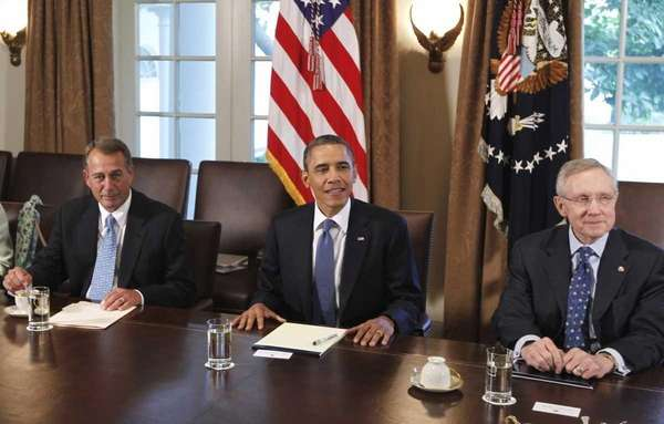 President Barack Obama, flanked by House Speaker John