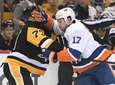 Matt Martin #17 of the Islanders battles with