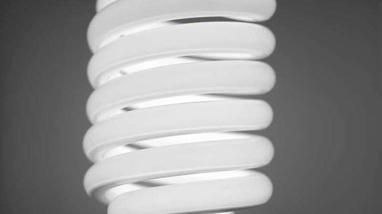 A compact fluorescent light bulb is seen in