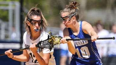 Danielle Pavinelli (left) of Northport squares off against