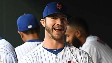 The Mets' Pete Alonso looks on in the