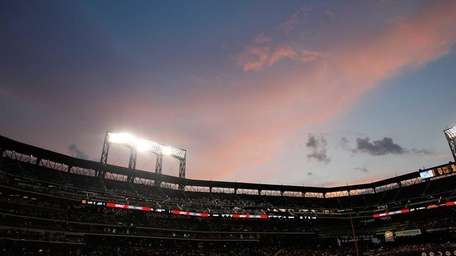 The sun sets during the game between the