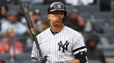 The Yankees' Giancarlo Stanton reacts against the Orioles