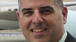 Jon-Michael Lasher, 45, of Selden, died of brain