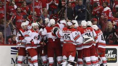 The Hurricanes celebrate their victory over the Capitals