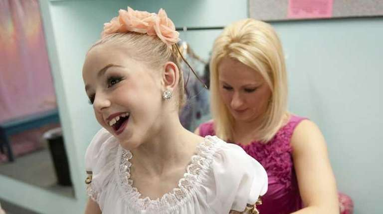 Christi helps her daughter Chloe get ready for