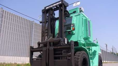 Remote-controlled forklift for removing radiation contaminated rubble at