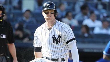 Yankees left fielder Clint Frazier reacts by breaking