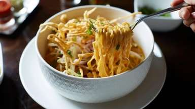 Khao soi noodle curry with egg noodles and