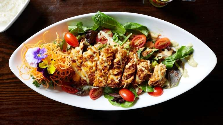 Larb gai is a fiery, ground-chicken salad with