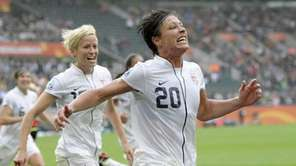 United States' Abby Wambach celebrates scoring her side's