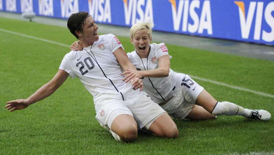 United States' Abby Wambach celebrates with United States'