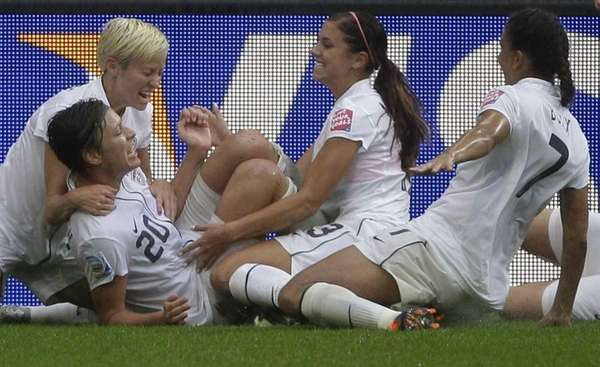 United States' Abby Wambach, second left, celebrates with