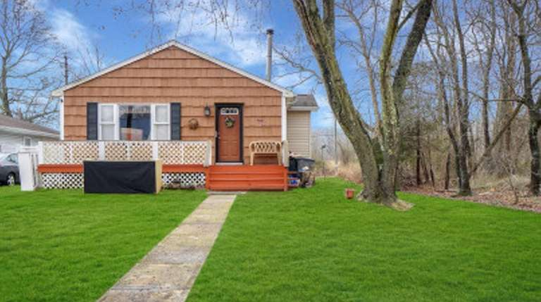 This Mastic Beach home  has three bedrooms,