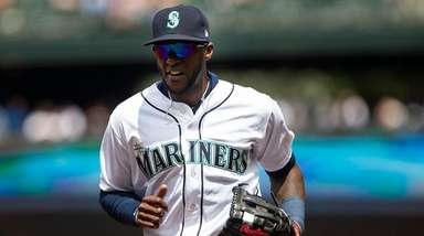 Cameron Maybin runs off the field after the