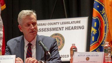 The Nassau County legislator Richard J. Nicolello, presiding