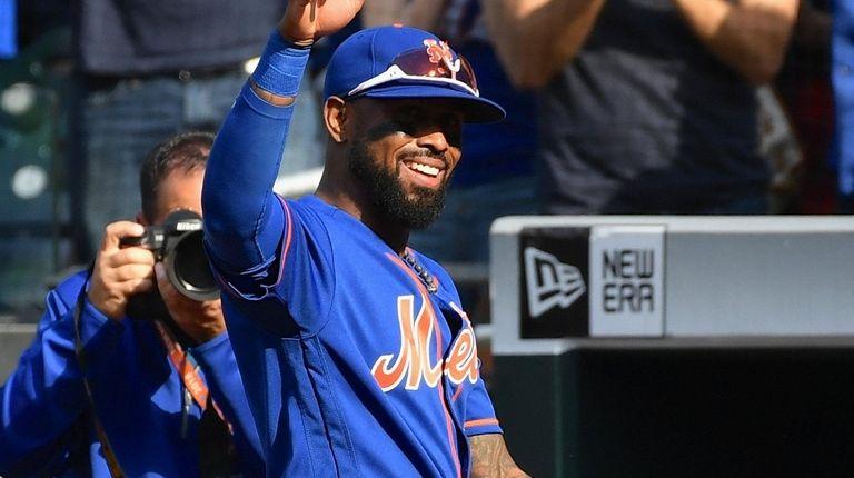 Mets shortstop Jose Reyes acknowledges fans as he