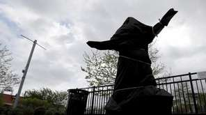 The covered Kate Smith statue sits outside Wells