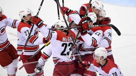 The Carolina Hurricanes celebrate after Game 7 of