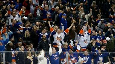 Fan cheer after the Islanders scored a third-period