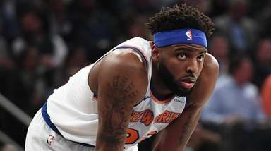 Knicks center Mitchell Robinson looks on against the