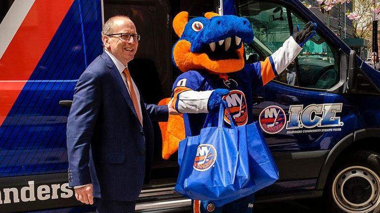 Islanders co-owner Jon Ledecky arrives with team mascot