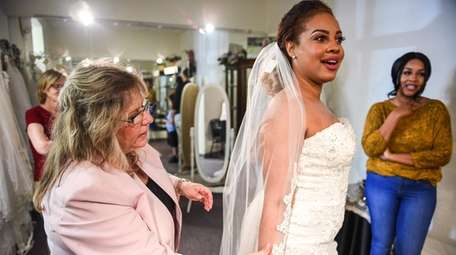 Donna Mause, left, owner of Renate's Wedding Boutique
