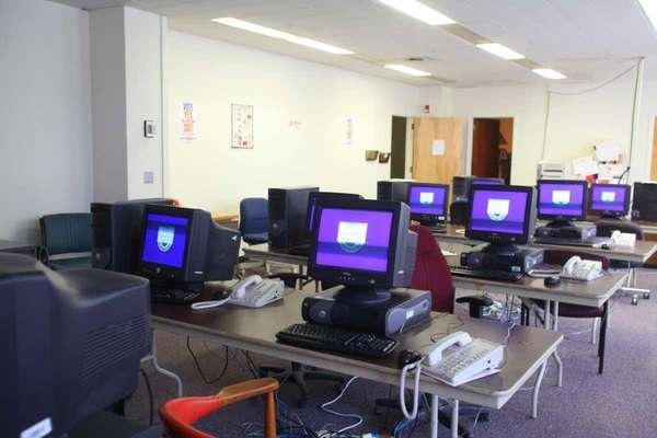 Phones and computer monitors are lined up on