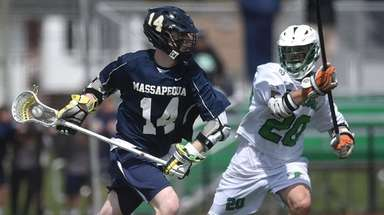 Colin Gleason #14 of Massapequa, left, moves the