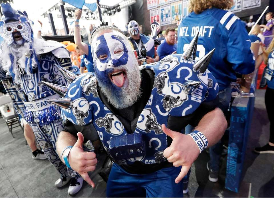 A Indianapolis Colts fan cheers ahead of the