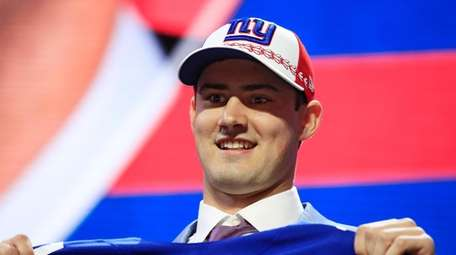 Daniel Jones of Duke reacts after being chosen