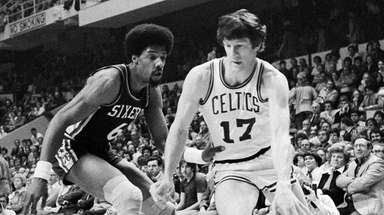 The Celtics' John Havlicek moves the ball past