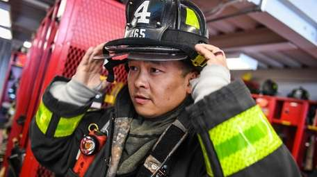 Bo Tian, of Syosset Fire Department, puts his