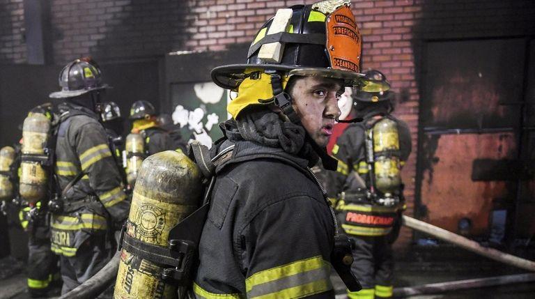 Volunteer firefighter Sattwa Conrad, from the Oceanside Fire