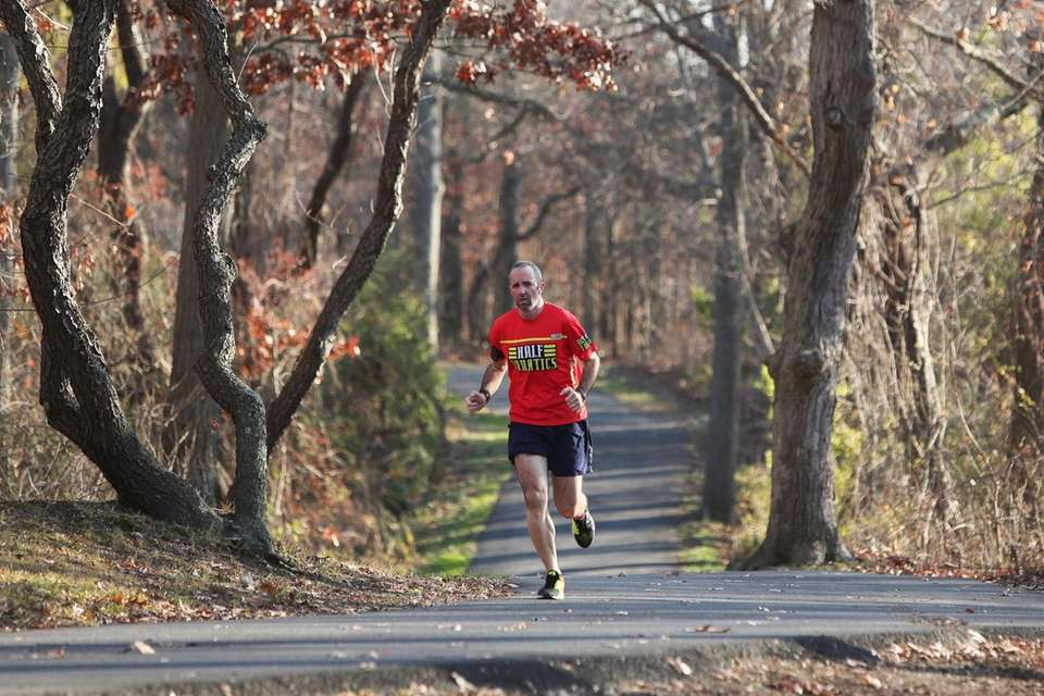 A man runs through Bethpage State Park in