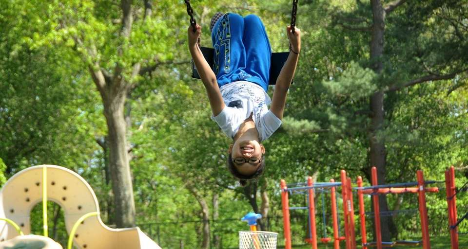 Toni Flaherty, 8, of Elmont, gets an upside-down