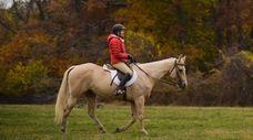 Henriette Darrell, of Cold Spring Harbor, rides her