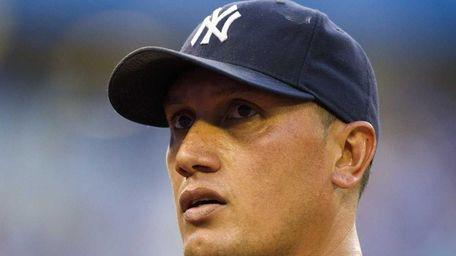 New York Yankees starting pitcher Freddy Garcia walks