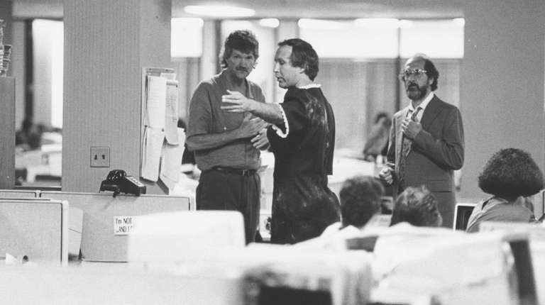 Chevy Chase, center, films a scene for his