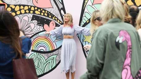 "Taylor Swift surprised fans at the ""What Lifts"