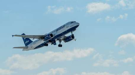 A JetBlue flight takes off during a demonstration