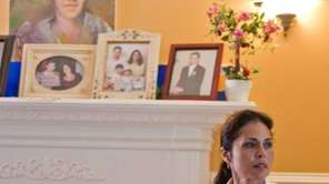 Patricia Rooney sits inside her Seaford home, where