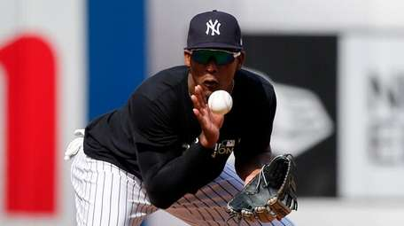 Miguel Andujar of the Yankees warms up in