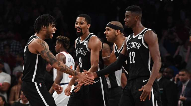 Nets guard D'Angelo Russell, left, and Nets guard