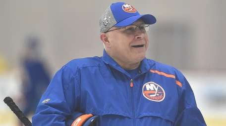 Islanders head coach Barry Trotz laughs with his