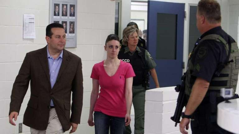 Casey Anthony, center, walks out of the Orange